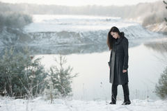Beautiful girl alone in winter forest Royalty Free Stock Photography