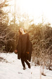 Beautiful girl alone in winter forest Royalty Free Stock Image
