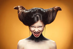 Beautiful girl with amazing hairstyle. Advertisment print for hairdressers. Royalty Free Stock Photos