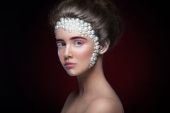 Beautiful girl with amazing make up and pearls and pink eye-shadows. Looking away. Beauty portrait. Creative make up. Horizontal photography. Dark background Royalty Free Stock Photos
