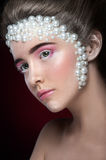 Beautiful girl with amazing make up and pearls and pink eye-shadows. Stock Photo