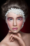 Beautiful girl with amazing make up and pearls and pink eye-shadows Stock Photo
