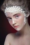 Beautiful girl with amazing make up and pearls and pink eye-shadows Stock Images