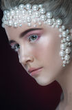 Beautiful girl with amazing make up and pearls and pink eye-shadows. Stock Images