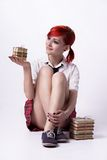 Beautiful girl in anime style with stacks of books Royalty Free Stock Image