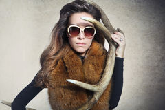 Beautiful girl with antlers Royalty Free Stock Image