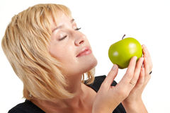 Beautiful girl with apple. Beautiful blond girl with green apple isolated on a white Royalty Free Stock Photos
