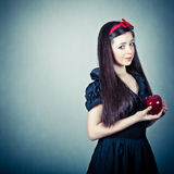 beautiful girl with an apple Stock Photography