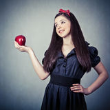 beautiful girl with an apple Royalty Free Stock Photo