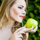 Beautiful girl with an apple Stock Photo