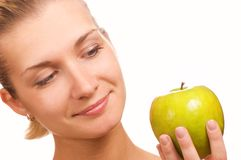Beautiful girl with an apple Royalty Free Stock Photos