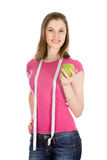 Beautiful girl with an apple. Isolated Stock Photo