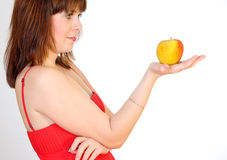 Beautiful girl with apple on palm Stock Photography