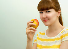 Beautiful girl with apple. Royalty Free Stock Photo