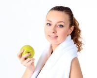 A beautiful girl with an apple, white background Royalty Free Stock Photo