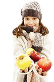 Beautiful girl with apple. Winter style. Royalty Free Stock Photos