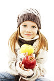 Beautiful girl with apple. Winter style. Stock Photo