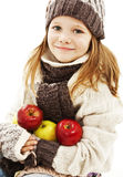 Beautiful girl with apple. Winter style. Stock Photography