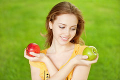 Beautiful girl with apples Stock Photography