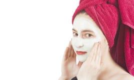 girl applying beauty face mask Stock Images