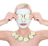 Beautiful girl applying facial mask of cucumber Stock Photo