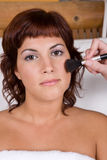 Beautiful girl applying make up - Beauty and Spa Stock Photo