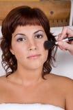 Beautiful girl applying make up - Beauty and Spa Stock Photo