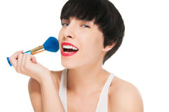 Beautiful girl applying make up Royalty Free Stock Image