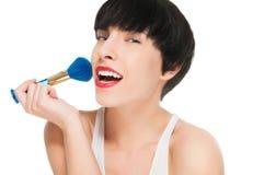Beautiful girl applying make up Royalty Free Stock Image