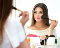 Beautiful girl applying makeup Royalty Free Stock Image