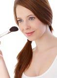 Beautiful Girl Applying Makeup Smiling Stock Photo