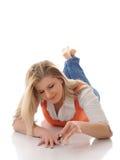 Beautiful girl applying nail polish Stock Photos
