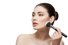 Beautiful girl applying powder with brush Stock Image