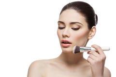 Beautiful girl applying powder with brush Stock Photo