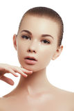 Beautiful girl applying some cream to her face for skin care. Youth and skin care concept royalty free stock photos