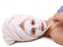 Beautiful girl applying spa mask on face Stock Photos
