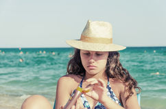 Beautiful girl applying sun block cream Stock Photography