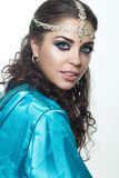 Beautiful girl in the Arab image with bright oriental make-up. Stock Image