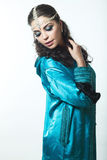 Beautiful girl in the Arab image with bright oriental make-up. Royalty Free Stock Photo