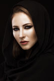 Beautiful girl in the Arab scarf with oriental make-up. Beauty face. Stock Images