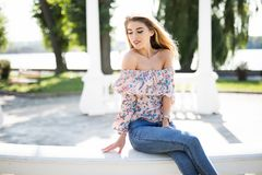 The beautiful girl on an arbour handrail in summer park. The beautiful girl on an arbour handrail Royalty Free Stock Photos