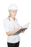 Beautiful girl architect engineer takes notes. Royalty Free Stock Images