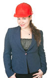 Beautiful girl architect in red hardhat royalty free stock photo