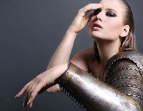 Beautiful girl in armor Stock Photo