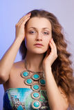 Beautiful girl with arms around her face Stock Images