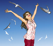 Beautiful girl with arms outstretched on blue sky  Royalty Free Stock Photo