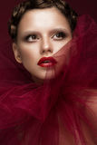 Beautiful girl with art creative make-up in image of red bride for Halloween. Beauty face. Stock Photography