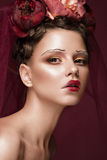 Beautiful girl with art creative make-up in image of red bride for Halloween. Beauty face. royalty free stock photography