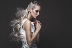 Beautiful girl in art dress with avant-garde hairstyles. Beauty face. Royalty Free Stock Image