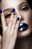 Beautiful girl with art make-up, dark glitter lips design and manicured nails. beauty face. Stock Images